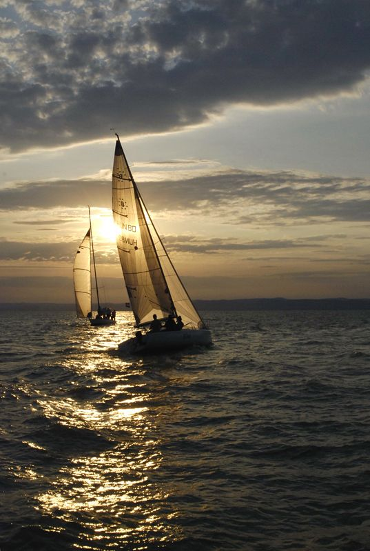 Sailing at sunset on Balaton Lake, Hungary (by Jakab).