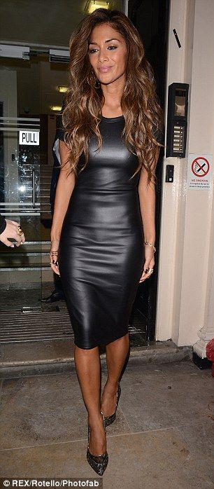 Lady in leather: Nicole Scherzinger cuts quite a figure in this figure-hugging black dress #hourglass body shape