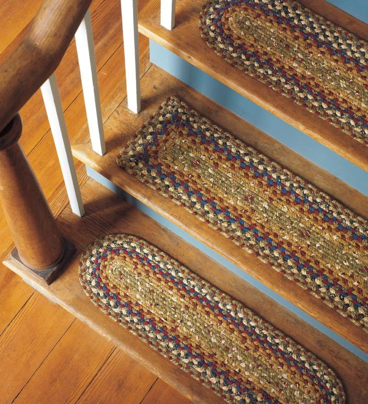 Crazy about braided rugs - finally! Something I like for my stairs
