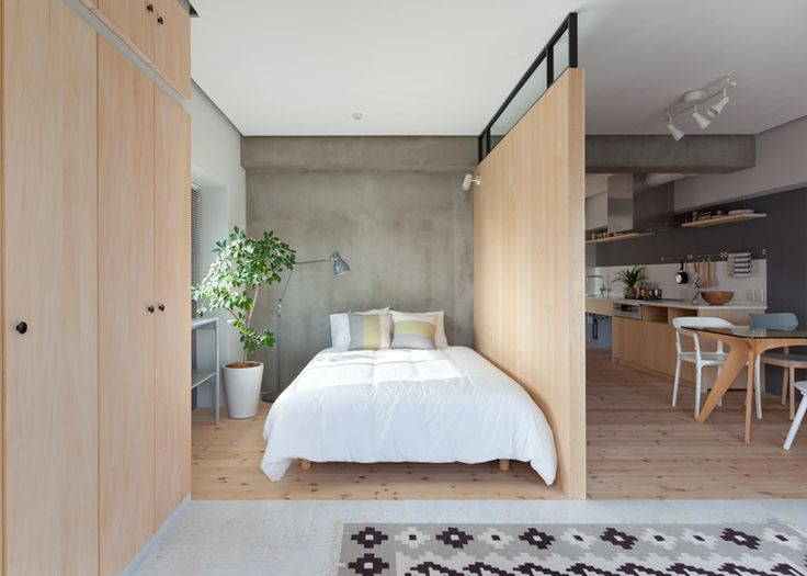 Two bedrooms are hidden behind an L-shaped wall in this Japanese apartment.