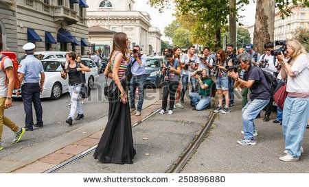 MILAN, ITALY - SEPTEMBER 17, 2014: Woman poses outside Gucci catwalk show building as part of Milan Women's Fashion Week on SEPTEMBER 17, 2014 in Milan