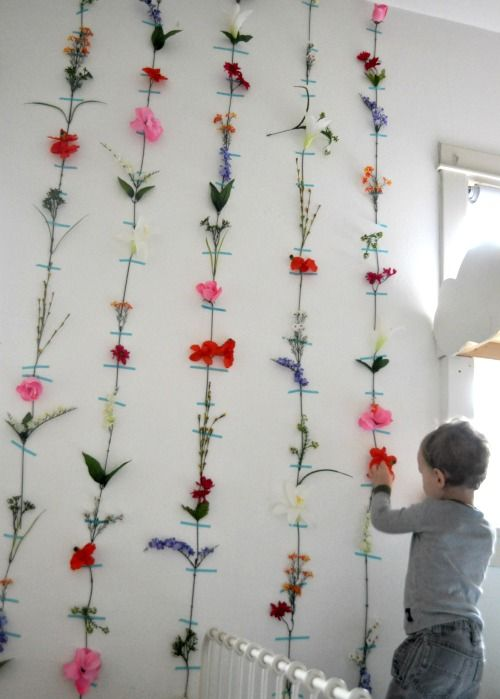 A quirky wall of taped-up flowers.                             Gloucestershire Resource Centre http://www.grcltd.org/scrapstore/