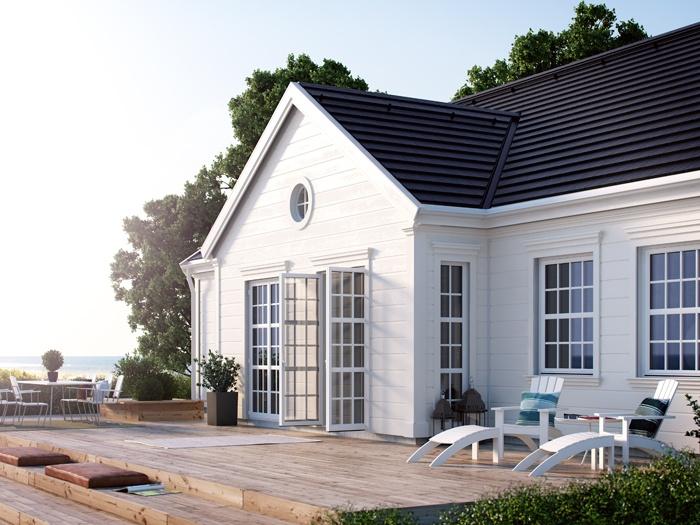 Snygga fönsterkarmar och lister kribg tak och dörrar på ett trähus Millers Cove | Ocean Living | Ett enplanshus i New Englandstil.