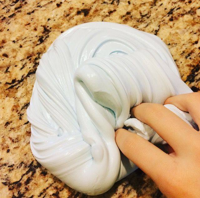 Easy, Fun and stretchy slime starting with only two ingredients!   1.) Elmer's glue 2.) Tide laundry detergent  3.) Shaving cream to make it fluffy (optional)
