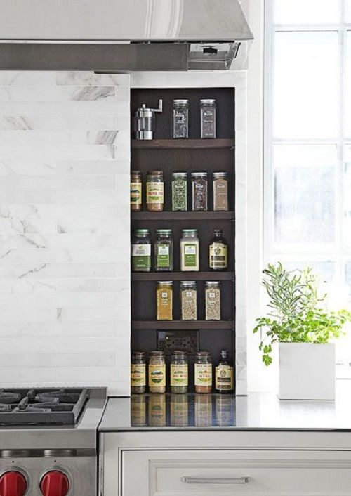 Save your drawer space and hide your extensive spice collection behind your marble backsplash! From Our Blog at Design Connection, Inc. | Kansas City Interior Design http://www.designconnectioninc.com/dream-kitchen-must-haves/