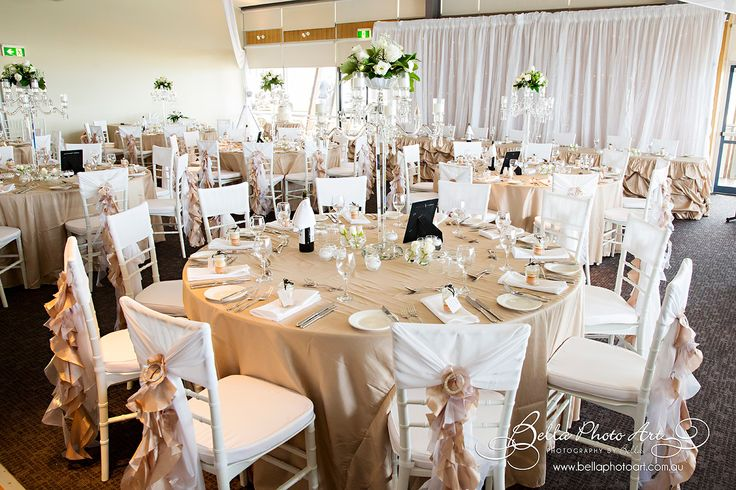 Fort Scratchley function centre #Newcastle Mel & Gregs #wedding #backdrop #bridaltable #fairylights #chandelier #ceilingdrapery #beige #tablecloths #white #tiffany #chairs #ruffled #chaircovers @Fort Scratchley Newcastle