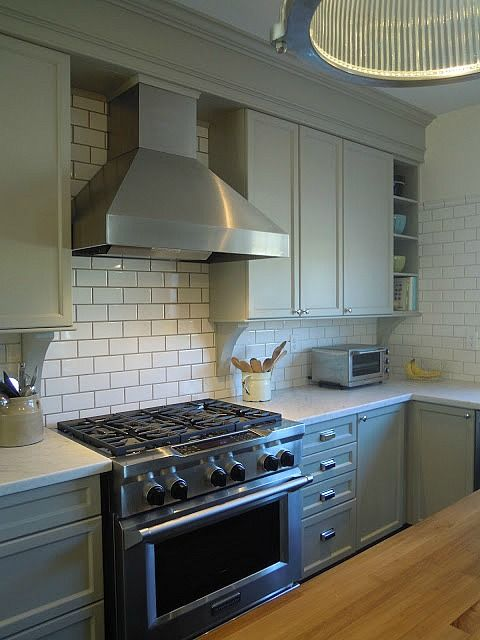 Easy Kitchen Remodel - new range, hood, tiles, molding, counters, and paint.