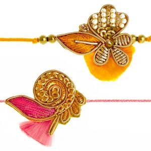 This splendid pair of rakhis are artistically handmade using zardozi and pearls neatly hand-woven with resham thread to give these rakhis a colorful look. Rs 450/- http://www.tajonline.com/rakhi-gifts/product/rdr79/zardozi-rakhi-set-of-2/?aff=pint2014/