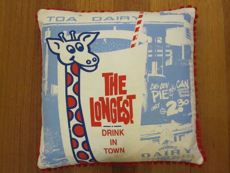"""""""The Longest Drink In Town"""" cushion."""