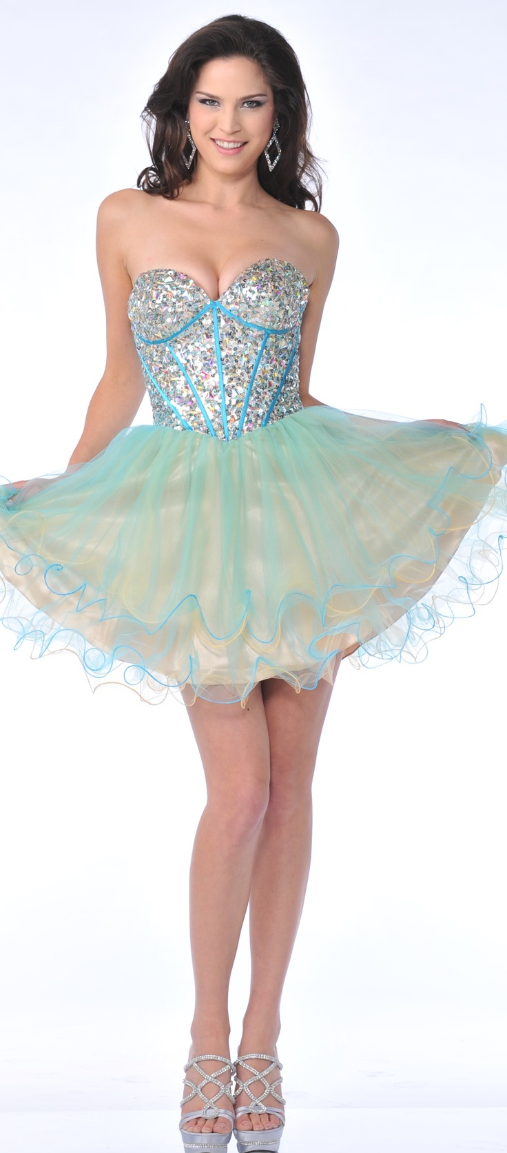 Unexpected Way to the top in this short corset dress with the bodice filled with beads and stones and followed by the short voluminous skirt with sheet netting overlay.  $138.00
