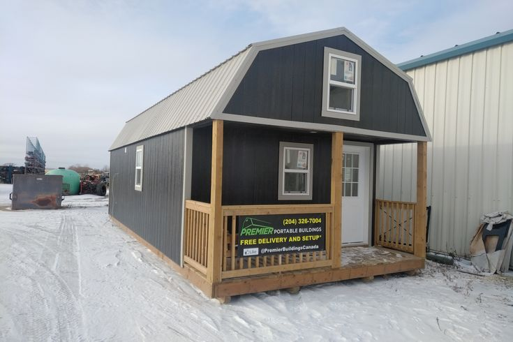 Completed Turn Key Shed to House from Premier Portable Buildings. 14x32 Lofted Barn Cabin