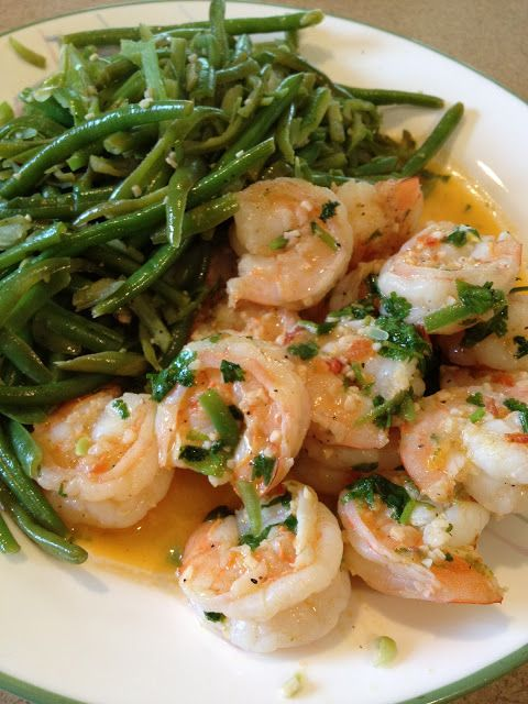 Cilantro Lime Shrimp & Green Beans  Servings: 4 • Serving Size: 6 oz shrimp & 1-1/2 cups green beans   Calories: 257.3 • Fat: 5.1g • Protein: 35.9 g • Carb: 17.4 g • Fiber: 4.1 g...2 tsp olive oil  2 lb shrimp, shelled and deviened  6 cloves garlic, crushed  1/3 cup chopped fresh cilantro  1 lime  salt and pepper  6 cups green beans