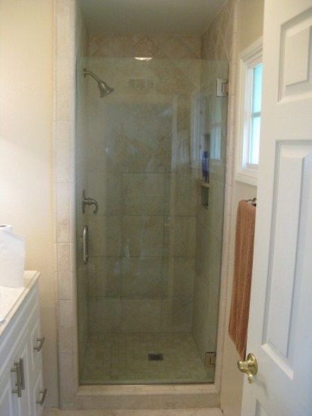 A Super Thick Frameless Door For The Shower Stall Is A
