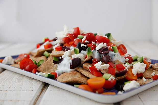 Greek Nachos - Put cucumber/yogurt sauce on chips first, then rest of ingredients. Feta goes on at the end.