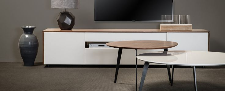 Hudson Collection entertainment unit. Simple and elegant design with fine lines, the Hudson Collection is finished in White Gloss, or Walnut veneer and matt white.