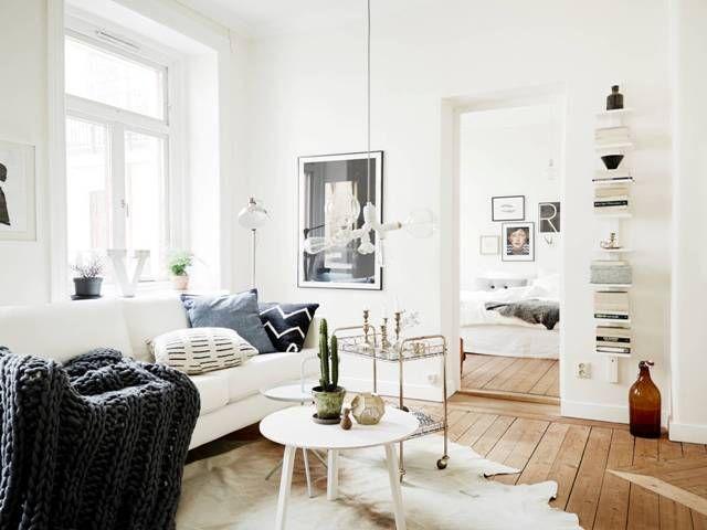 A serene Swedish home in white and wood
