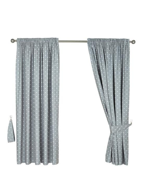Dotty Blackout Pleated Curtains Dotty Pencil Pleat Thermal Blackout Curtains - darkness has never looked so colourful! Perfect for children's bedrooms or those who like a lie-in at the weekend, these Dotty blackout curtains feature a pretty spot design on a colourful background.Available in blue, natural and pink colour options, the style of the pleated blackout curtains helps give your room a country cottage charm, and the blackout lining ensures your slumber isn't interrupted by ear...