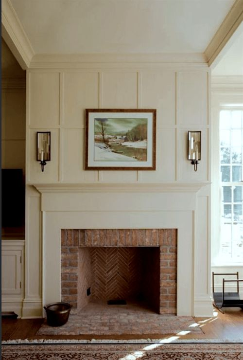 beautiful paneled fireplace surround over a brick fireplace