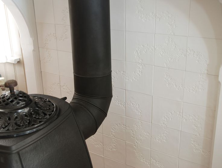 tex-tiles in fire hood in living room #tiles #transparant #white #translucent #porcelain #15x15 #bathroom #textiles #wall #decoration #led #imprint #relief #barbaravos #wallcovering #kitchen #shower #home #interior #design #glaze #backsplash #flower #pattern #coral #fabric