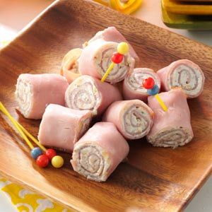 "Ham 'N'  Cheese Pinwheels Recipe -Andrea Bolden of Unionville, Tennessee shares this recipe for convenient make-ahead snack. ""I love the garlic flavor in these roll-ups. Every time I serve them, they're a hit,"" she says."