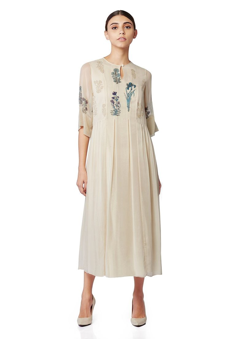 A chic, midi dress with flower motifs at the yoke and sleeves. INR 9,990.00
