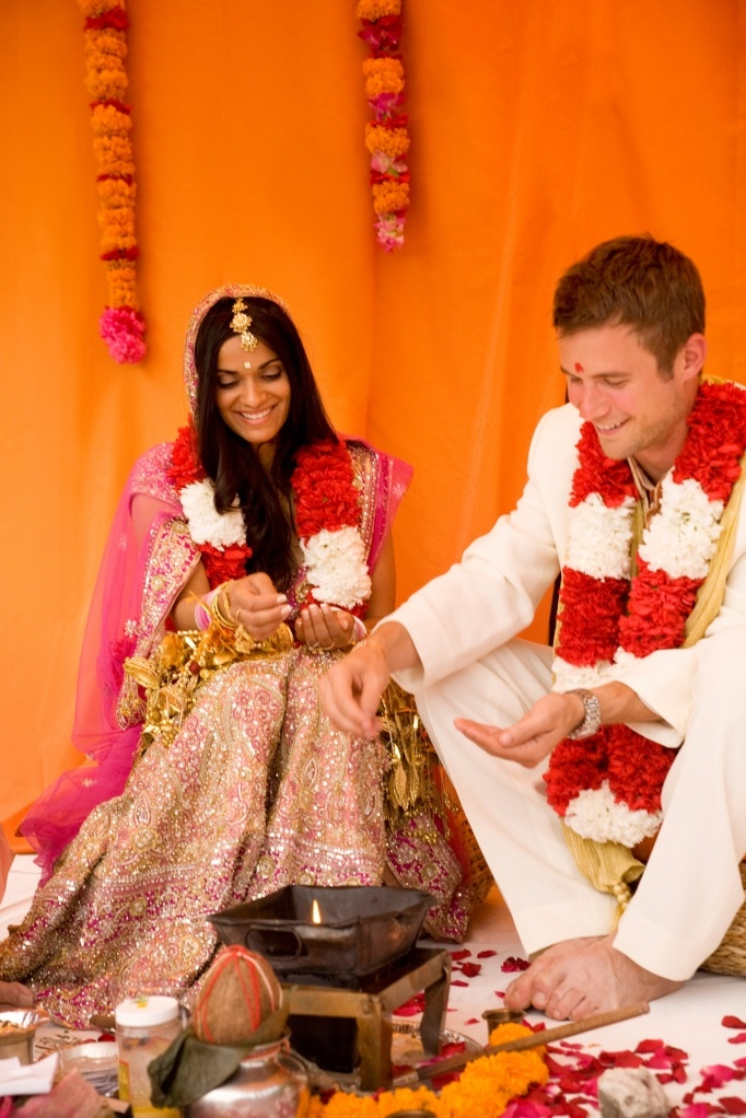 Indian wedding ceremony, stunning orange and pink colors