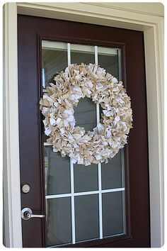 rag wreath tutorial {using a four-ring wreath frame}...love the neutral ones that mix in textured fabrics like burlap and linen   {maybe to hang somewhere in our living room/dining room?}