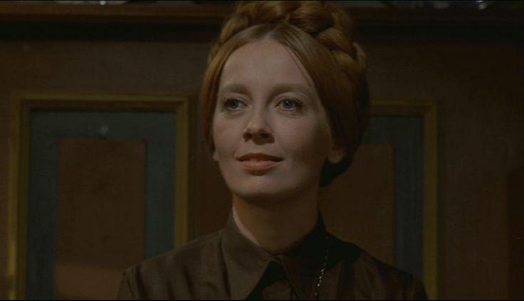 som sognerådsformand Emma Boserup, i Motorvej på sengekanten fra 1972.