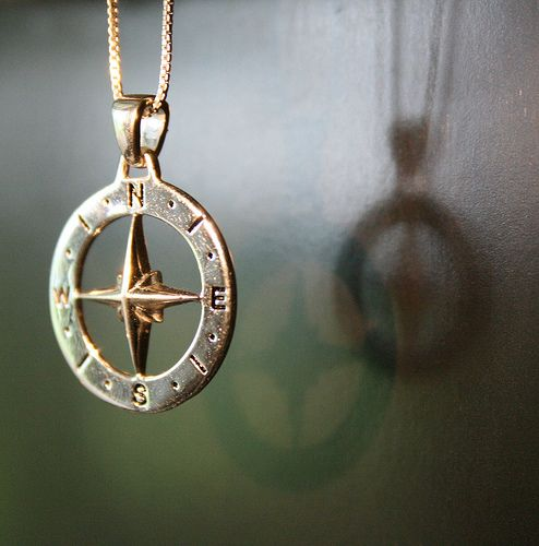 "Have this compass necklace in silver and where it everyday with my best friend charm and crucifix. The back read ""There are no shortcuts to anywhere worth going."""