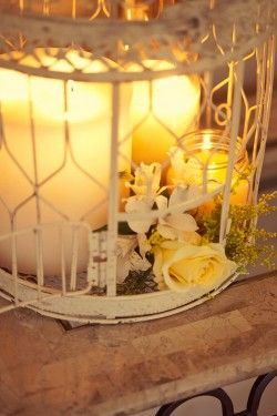 A votive and birdcage look is perfect for a very romantic wedding theme. Try this look to stay cozy and warm during the spring!