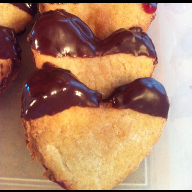 Cinnamon honey sandwiching raspberry jam, dipped in chocolate!