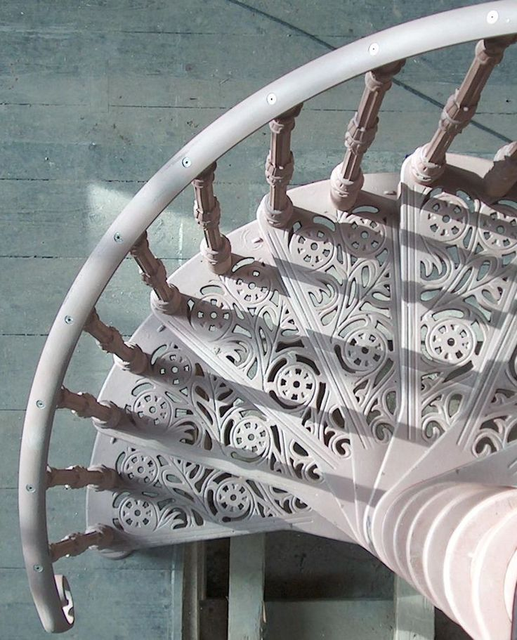 Cast iron spiral staircase with traditional tread and ballustrade
