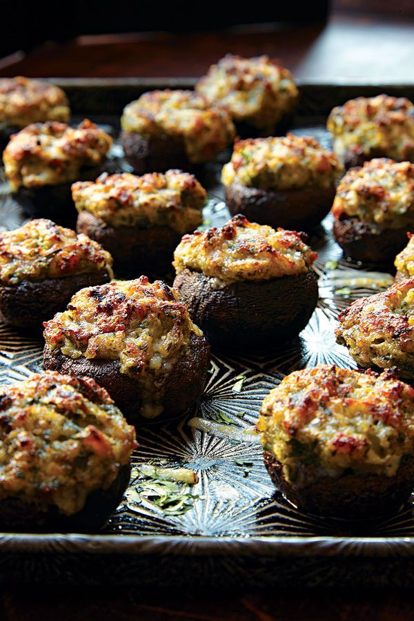 Each summer, at the Gilroy Garlic Festival in Gilroy, California—home to 90 percent of the American garlic crop—festivalgoers can nosh on a wide assortment of garlicky dishes, ranging from spaghetti enrobed in a pungent pesto to garlic ice cream. One of our favorites is this dish of garlic-stuffed mushrooms, which we've enhanced with a little dry sherry and nutty Gruyère cheese.