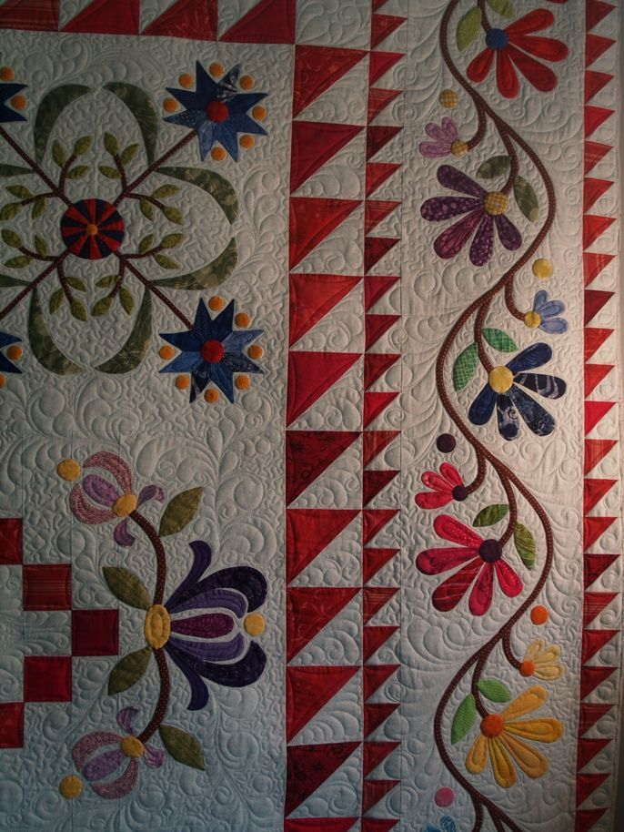 USING HALF SQUARE TRIANGLES FOR BORDER - very pretty : Based on Aunt Millie's Garden by Piece O Cake: