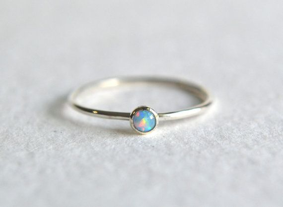 Sterling silver dainty blue opal ring. Super cute and tiny 3mm lab grown blue opal gemstone. The gemstone is set by hand in a sterling silver bezel. The band is sterling silver and thin at 1mm. Polished for a beautiful shine finish.  *Each order will arrive gift wrapped in a beautiful box and satin bow.  Also available in other colored opal gemstones as shown in third photo: White opal: www.etsy.com/listing/239988621/sterling-silver-opal-ring-stacking-ring Bright pink opal…