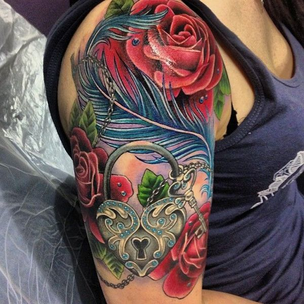 possible thigh tattoo, but change the roses to mine and the husband's birth flowers.