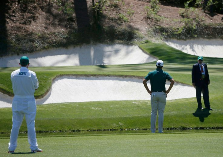 At Amen Corner, Masters Scores Turn for the Worse - NYTimes.com:  Adam Scott of Australia, the defending chapion, talking to a rules official after hitting a ball into the water on the 12th hole. He shot a 69 and is tied for second. 10 April 2014.