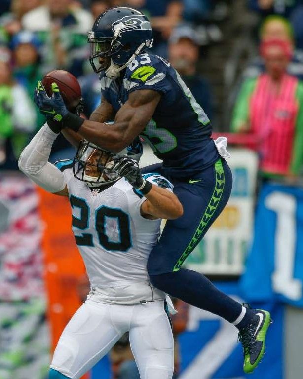 Wide receiver Ricardo Lockette #83 of the Seattle Seahawks makes a catch for a touchdown against defensive back Kurt Coleman #20 of the Carolina Panthers at CenturyLink Field on October 18, 2015 in Seattle, Wa. The Panthers defeated the Seahawks 27-23.