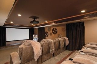 A theater room with massage chairs and blankies....oh yeah!