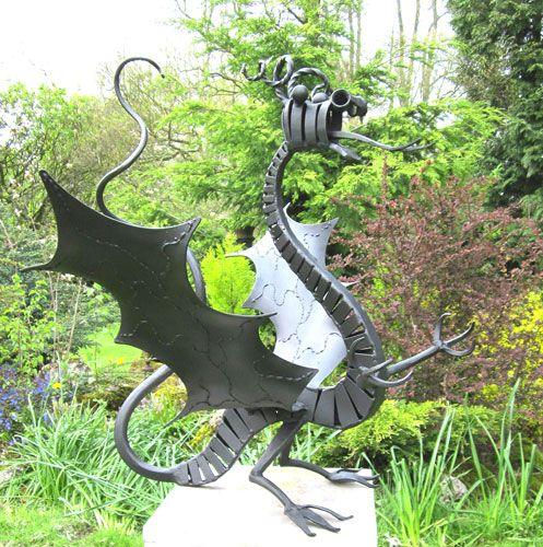 dragon sculpture in metal for gardens