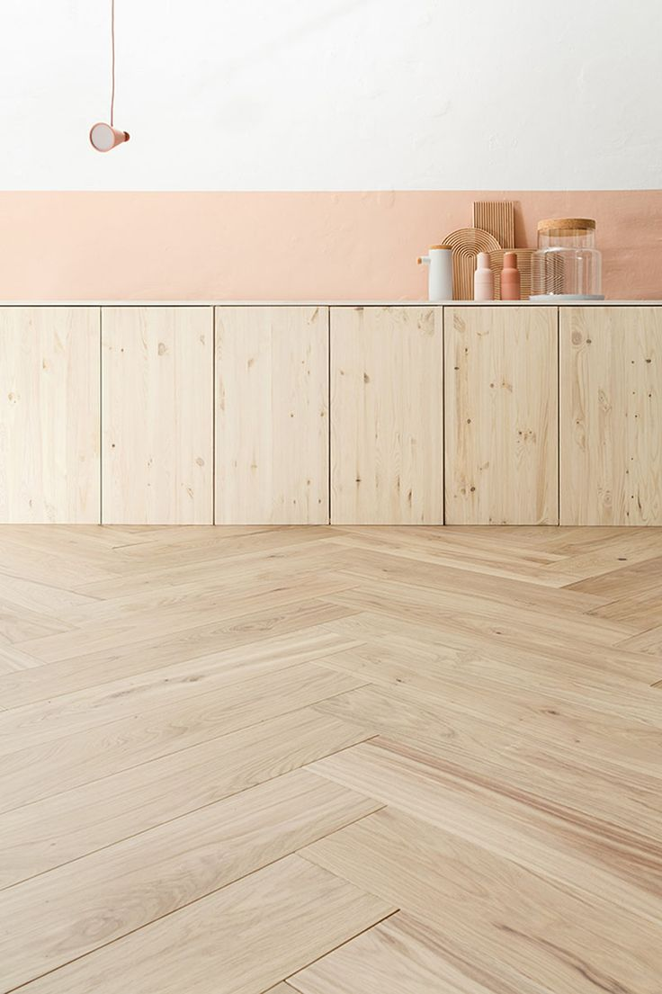 16 Inspirational Examples Of Herringbone Floors | This light wood flooring matches the cupboards perfectly.