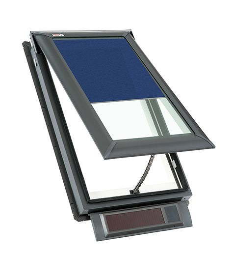 """VELUX No Leak Solar Powered """"Fresh Air"""" Skylight with a navy blue blackout blind.  It's automatically knows to close when it rains!"""