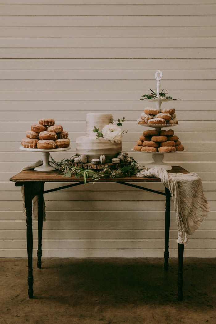 Wedding cake + donuts + macaroons = our idea of the best dessert options! | Image by Folk + Wayfarer