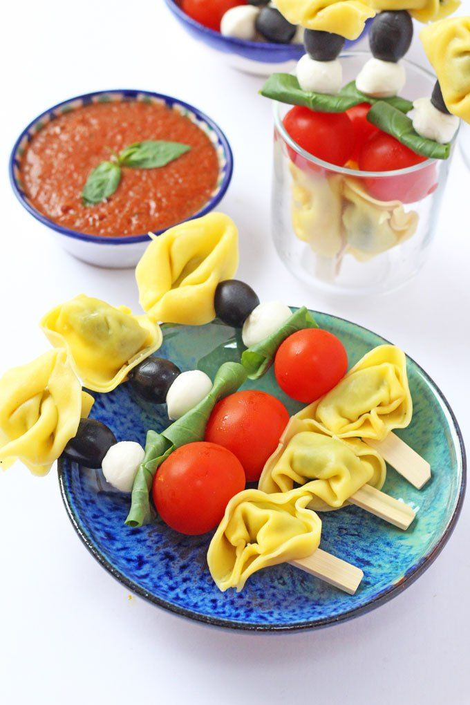 A fun way of serving tortellini.; on a stick with tomato, mozzarella and basil. Great for kids and picky eaters!