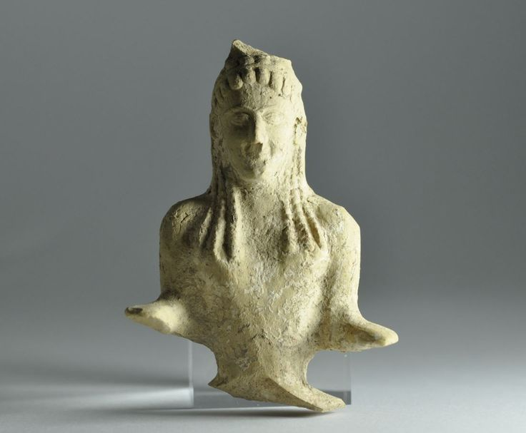 Magna Graecia terracotta figurine of seated goddess, 5th century B.C. Magna Graecia terracotta statuette of a seated goddess, 9.3 cm high. Private colelction