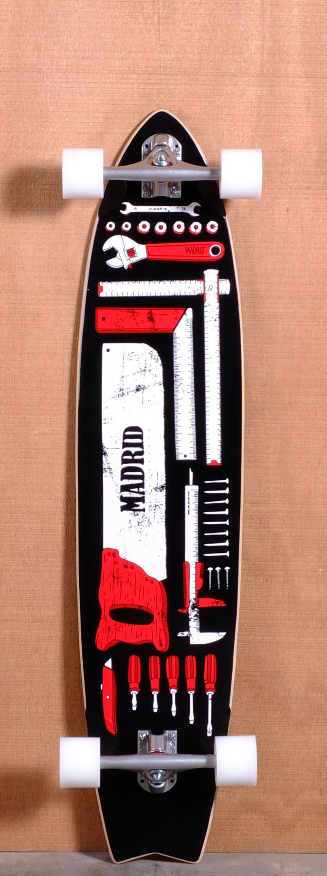 """The Madrid Tools Longboard Complete is designed for Carving and Cruising. Ships fully assembled and ready to skate! Function: Carving, Cruising Features: Concave, Swallow Tail, Wheel Wells Material: 9 Ply Maple Length: 41.625"""" Width: 9.25"""" Wheelbase: 29.75"""" Thickness: 7/16"""" Hole Pattern: New School Grip: Black"""