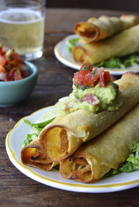 Baked Chicken and Cheese Taquitos. Introducing you to our new go-to Mexican recipe. Pour yourself a tall, cold beer and enjoy!