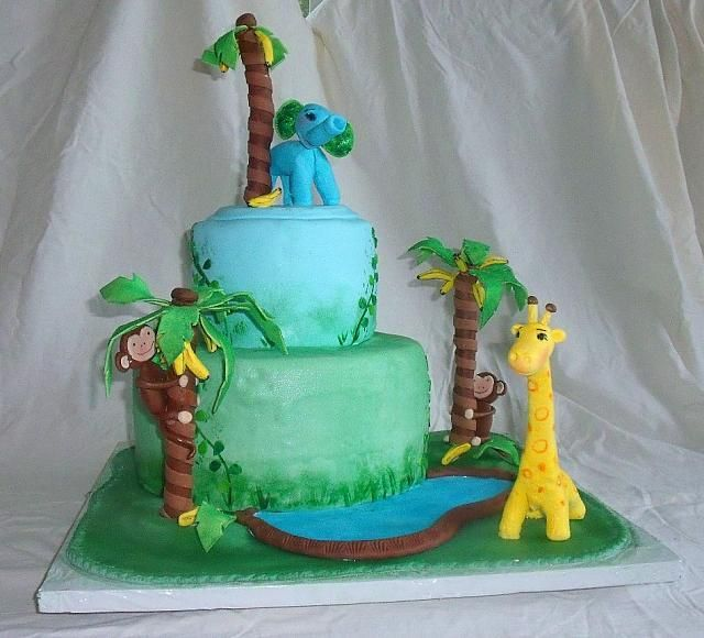 Jungle or safari baby shower cake with edible monkey in - Banana cake decoration ...