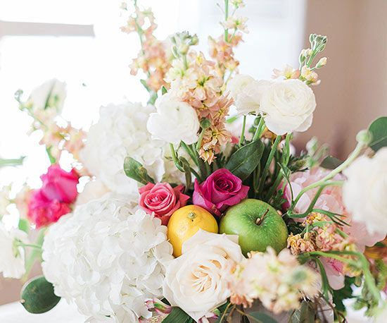 Fresh fruit adds a touch of whimsy to any floral arrangement.