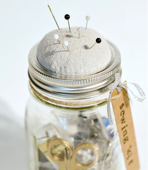 Keep your sewing supplies at the ready inside a Mason jar equipped with a DIY pincushion lid.